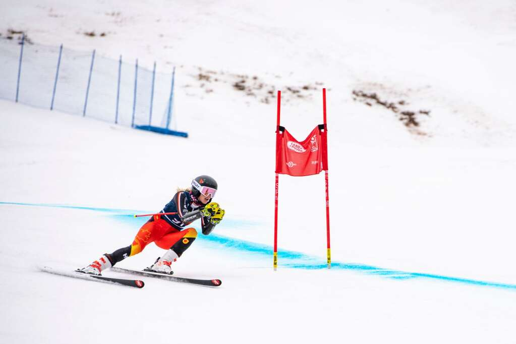 An alpine skier competes in the Women's super-G National Championships on Tuesday, April 13, 2021. (Kelsey Brunner/The Aspen Times)