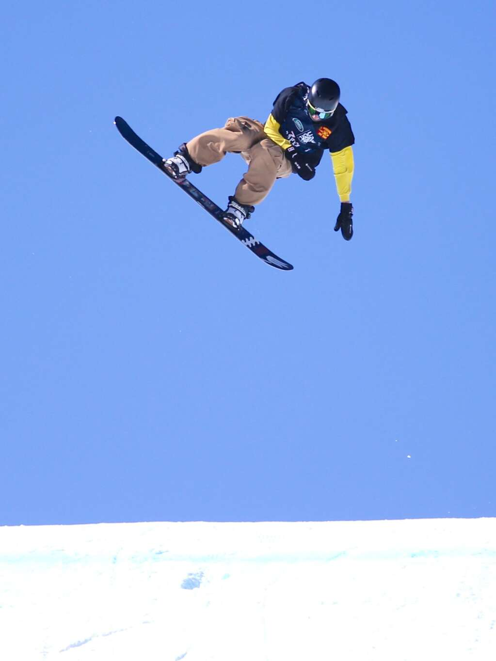 Canada's Jacob Legault competes in the men's snowboard slopestyle qualifier of the U.S. Grand Prix and World Cup on Friday, March 19, 2021, at Buttermilk Ski Area in Aspen. Photo by Austin Colbert/The Aspen Times.