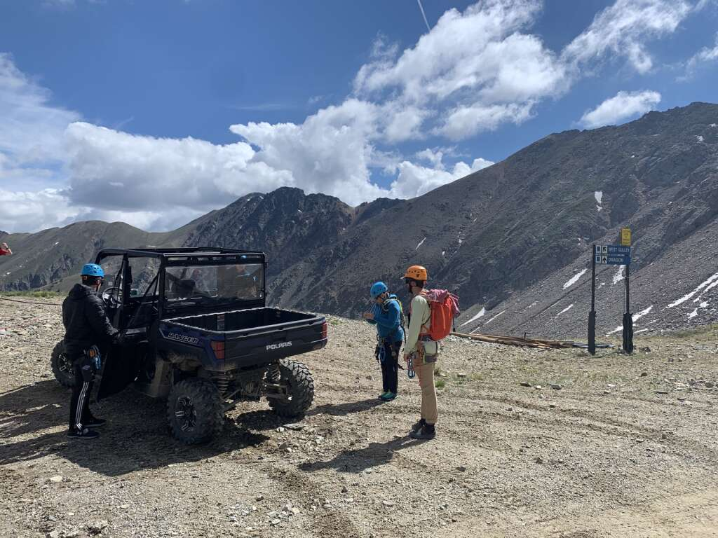Arapahoe Basin Ski Area via ferrata guides and guests prepare to hike from the top of the Lenawee lift through talus fields to the base of the via ferrata climb on the East Wall on Tuesday, June 29.   Photo by Antonio Olivero / aolivero@summitdaily.com