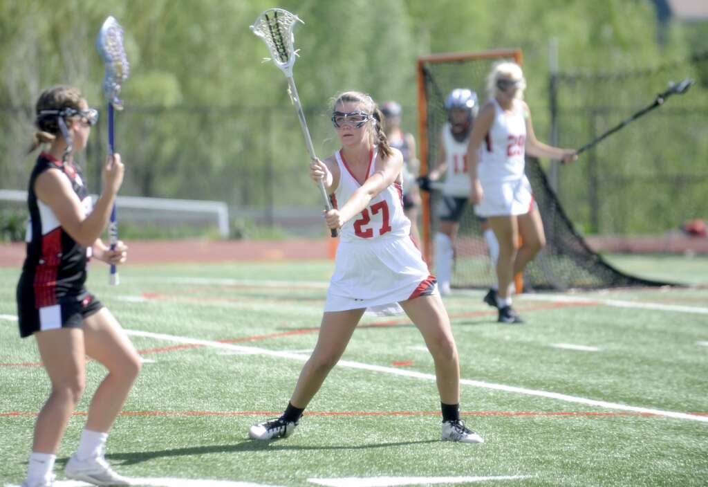Steamboat Springs girls lacrosse player Grace O. keeps herself between the goal and an opponent during a game against Eagle Valley at Gardner Field on Thursday night. (Shelby Reardon)
