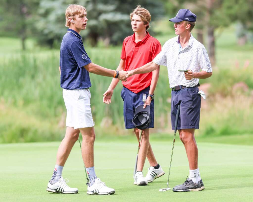 Aspen High School's Sky Sosna, right, shakes hands with Lucas Lee as Miles Butera stands nearby at the conclusion of their practice round on Tuesday, Aug. 3, 2021, at Aspen Golf Club. Photo by Austin Colbert/The Aspen Times.
