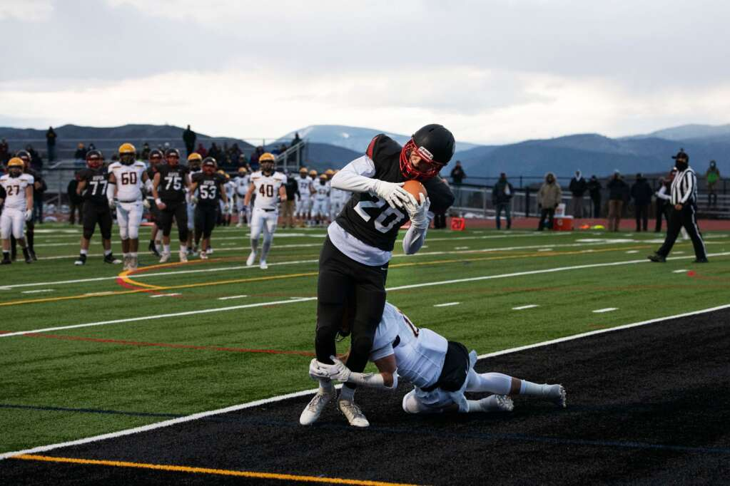 Aspen's wide receiver Cole Kennedy catches a pass in the end zone scoring the first Aspen touchdown in the last second of the first half of the game against Basalt High School at Aspen on Friday, April 16, 2021. (Kelsey Brunner/The Aspen Times)