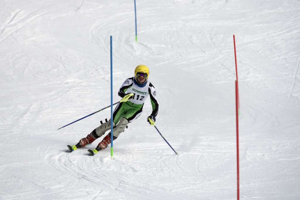 Summit High School Alpine ski team racer Kevin Reddell navigates gates while skiing the slalom course during the Colorado High School State Alpine Ski Championships at Loveland Valley Ski Area on Thursday, March 11, 2021. | Photo by Jason Connolly / Jason Connolly Photography