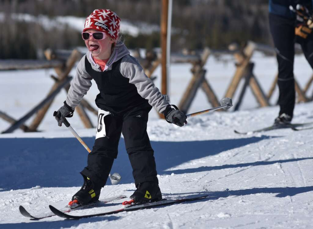 A young Nordic skier finishes the 2K fun race on Saturday. | Amy Golden / agolden@skyhinews.com