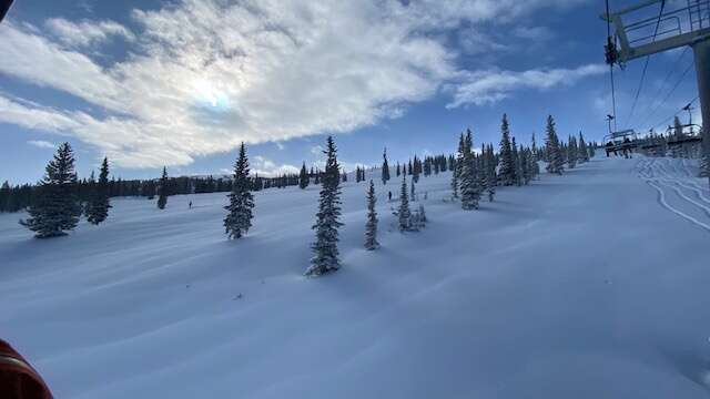 Those who made it out to first chair Thursday for the 20-inch powder day at Snowmass Resort were treated to deep tracks. The Sheer Bliss lift opened a little late after it was cleared by ski patrol, who kept their tracks near the rope line.  (David Krause / The Aspen Times)
