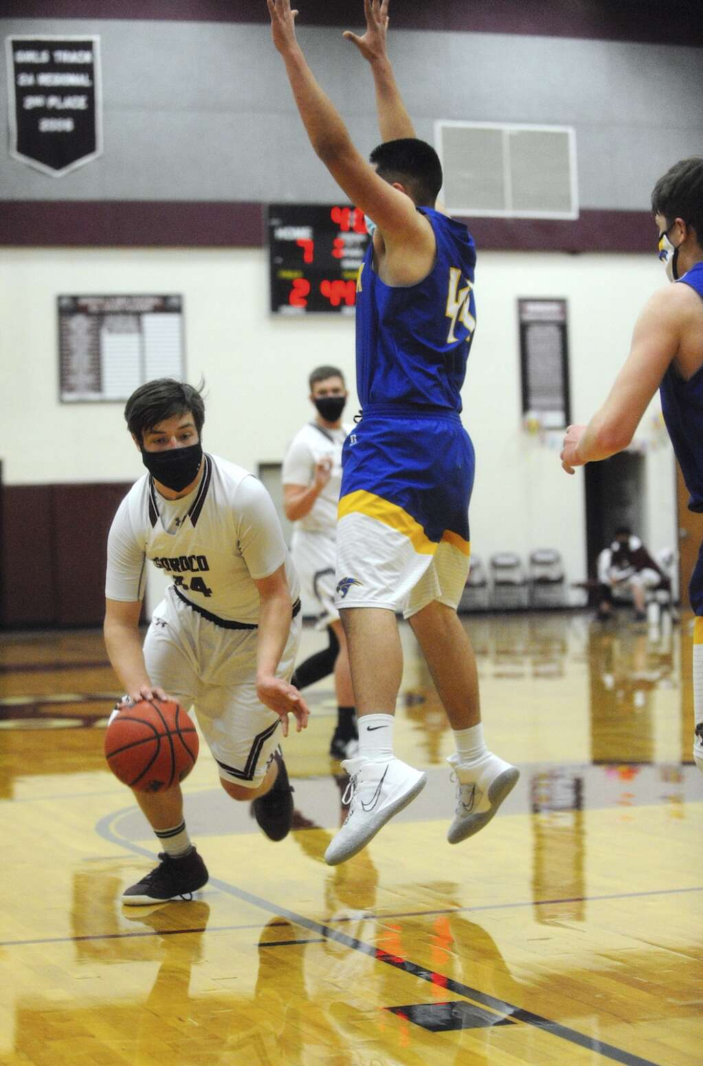 Soroco senior Chase Delamater dribbles around North Park sophomore Troy Gonzales during a game in Oak Creek on Saturday afternoon. (Photo by Shelby Reardon)