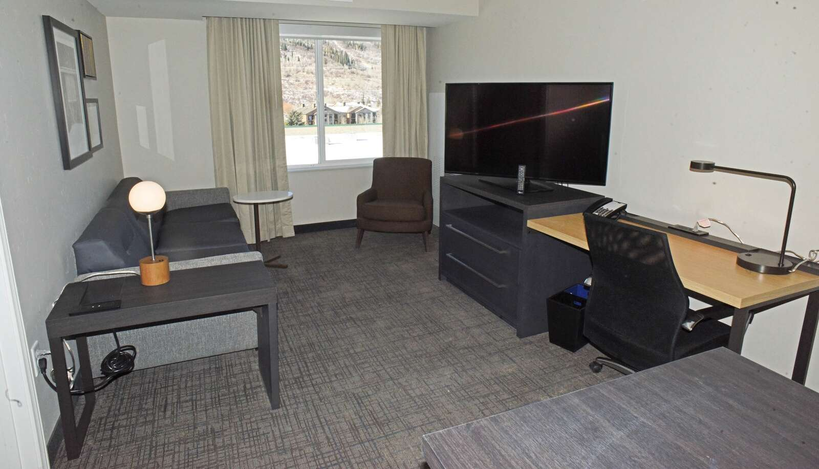 The living room inside this two-bedroom suite at the new Residence Inn by Marriott offers space to watch television, or to check in with the office. There is also a full kitchen, and two separated bedrooms. (Photo by John F. Russell)