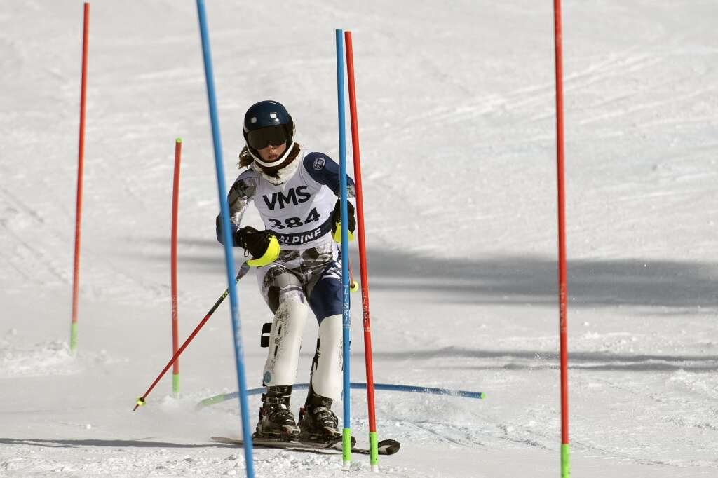 Vail Mountain School Alpine ski team racer  Kate Emma Burns navigates gates while skiing the slalom course during the Colorado High School State Alpine Ski Championships at Loveland Ski Area on Friday, March 12, 2021.   Photo by Jason Connolly / Jason Connolly Photography