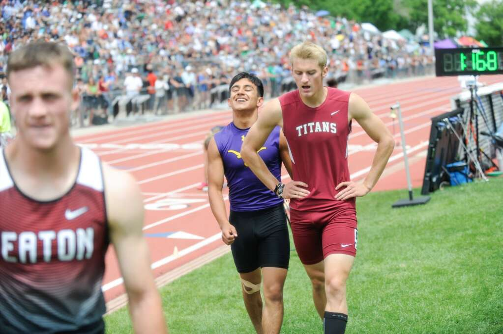Basalt High School senior Rulbe Alvarado, center, laughs off a close loss in the Class 3A boys' 400-meter sprint at the state track and field championships on Saturday, June 26, 2021, at Jefferson County Stadium in Lakewood. Photo by Shelby Reardon/Steamboat Pilot & Today.