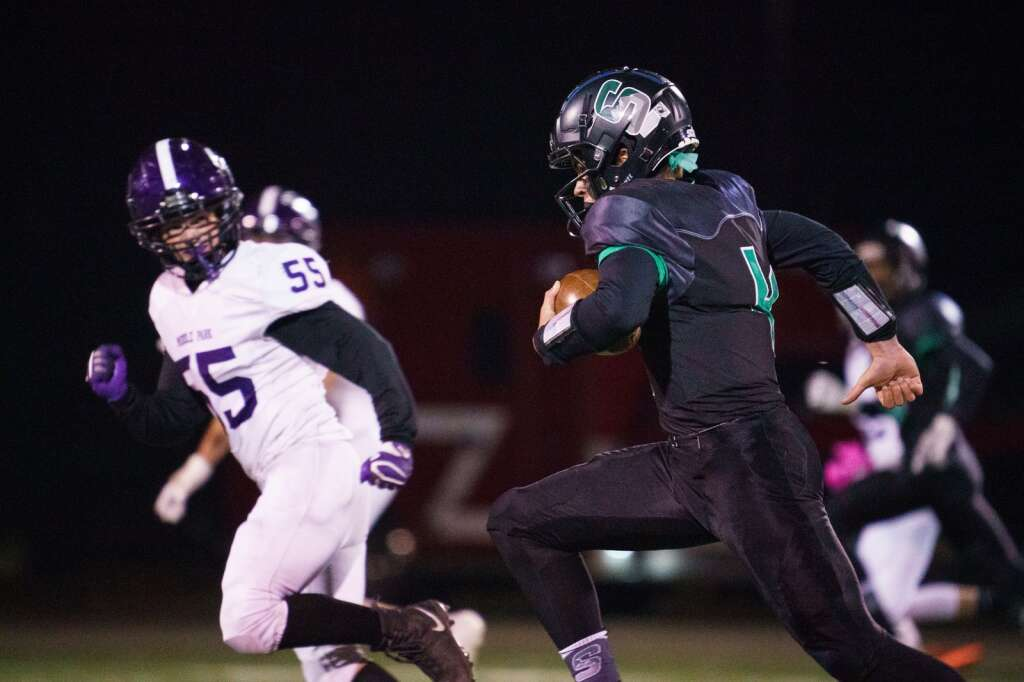 Summit quarterback Jack Schierholz runs with the ball during the the Tigers' homecoming win against the Middle Park Panthers on Friday, Sept. 24, at Tiger Stadium in Breckenridge. | John Hanson/For the Summit Daily News