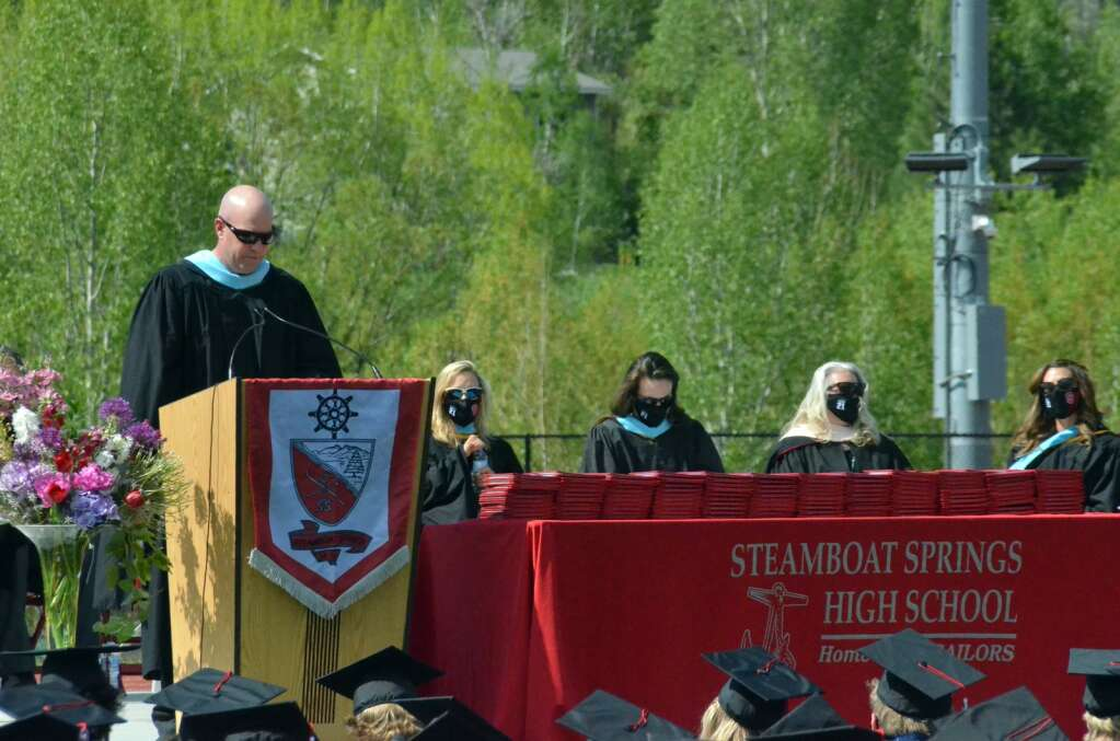 Interim Steamboat Springs High School Principal Dennis Alt welcomes the crowd Saturday morning. (Photo by Bryce Martin)