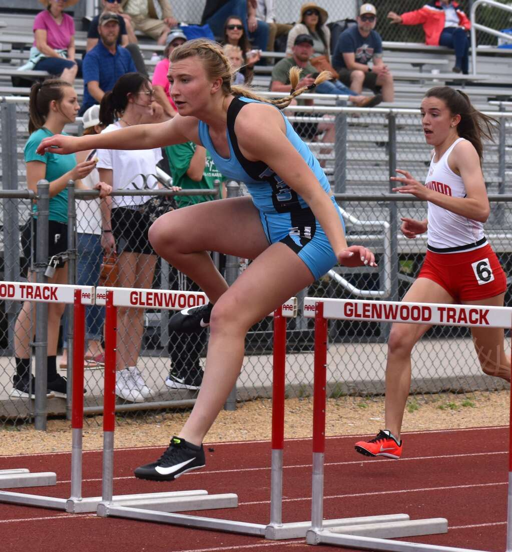 Coal Ridge's Raeanna Nelson clears a hurdle on the way to the 100M hurdle event win Saturday.| John Stroud/Post Independent