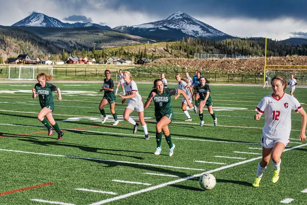 Brielle Quigley chases chases down Glenwood Springs' possession with teammates Lila Murray (left), Kelley Duffy and Maggie Barggren (right) in tow during Summit's 4-1 loss to Glenwood Springs at Tiger Stadium in Breckenridge on Tuesday . | Photo by Joel Wexler / Rocky Mountain Photography