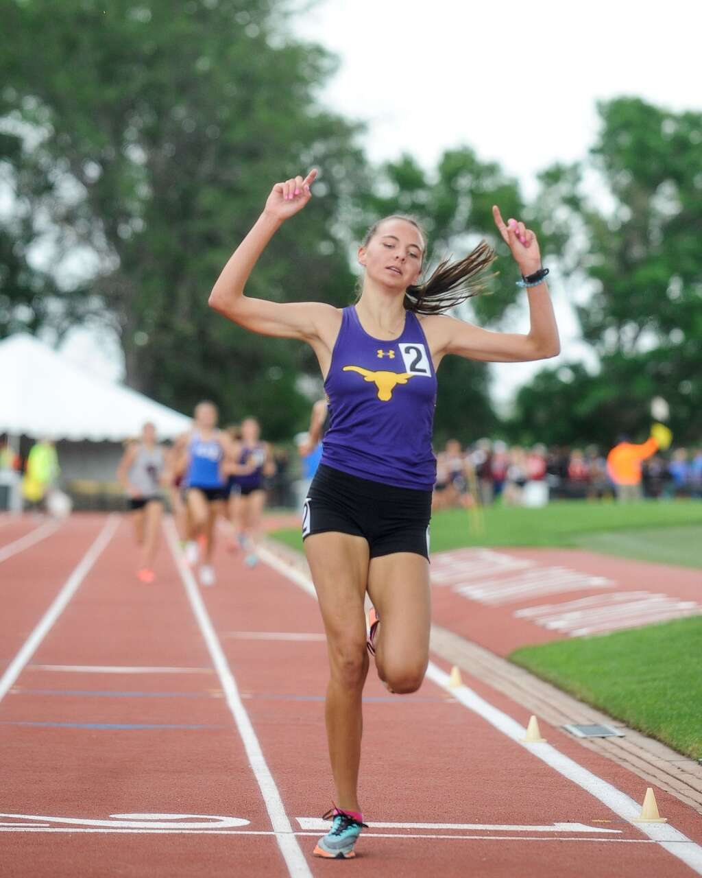 Basalt High School sophomore Katelyn Maley raises her hands as she crosses the finish line first to win the Class 3A girls' 1,600-meter run at the state track and field championships on Saturday, June 26, 2021, at Jefferson County Stadium in Lakewood. Photo by Shelby Reardon/Steamboat Pilot & Today.