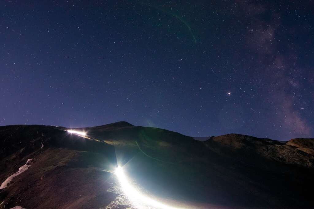 Illuminated by headlamps, mountain bikers race in a previous edition of The Mountain's Revenge 24-hour mountain bike race, a competition to see who can ride the most high-alpine backcountry loops near Montezuma and the Continental Divide. | Photo from Adam Shaw