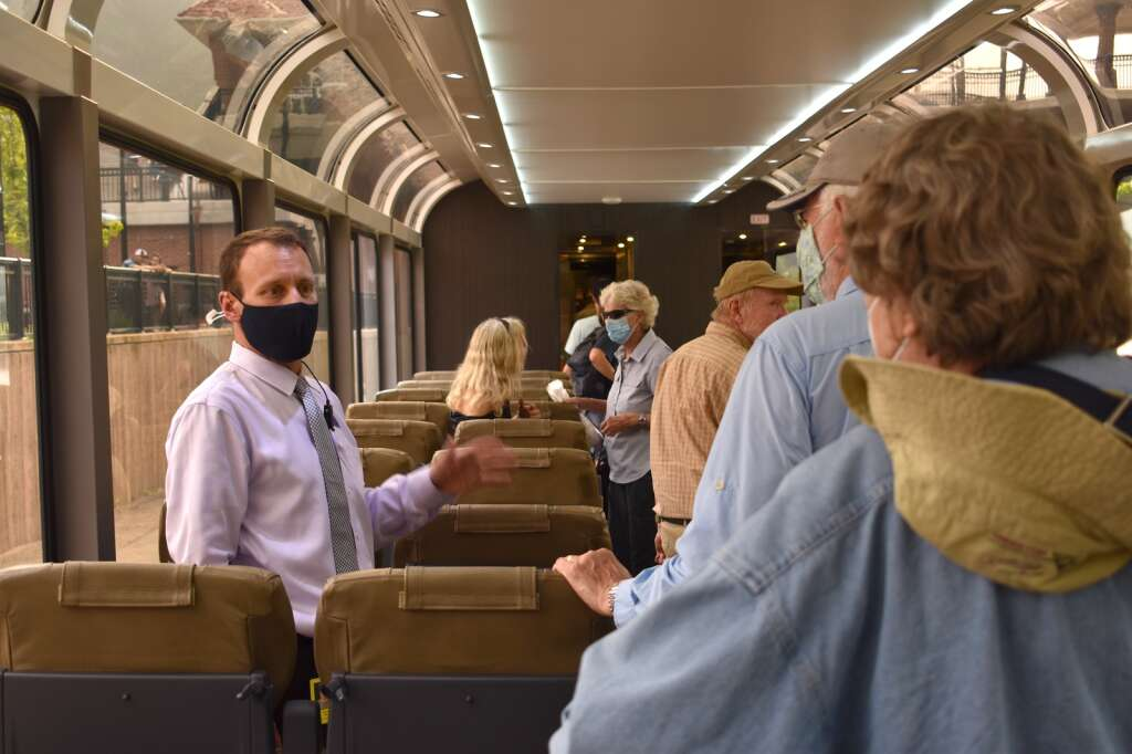 Rocky Mountaineer Director of On Board Operations Sean Richard gives a mini tour of the coach car during the train's overnight stop in Glenwood Springs Sunday, Aug. 15, 2021.