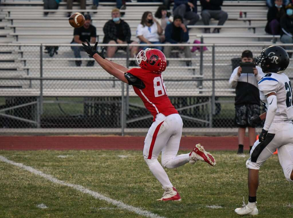 Glenwood Springs Demon Wheatley Nieslanik reaches and just misses the ball during Friday night's home game against the Coal Ridge Titans. |Chelsea Self / Post Independent