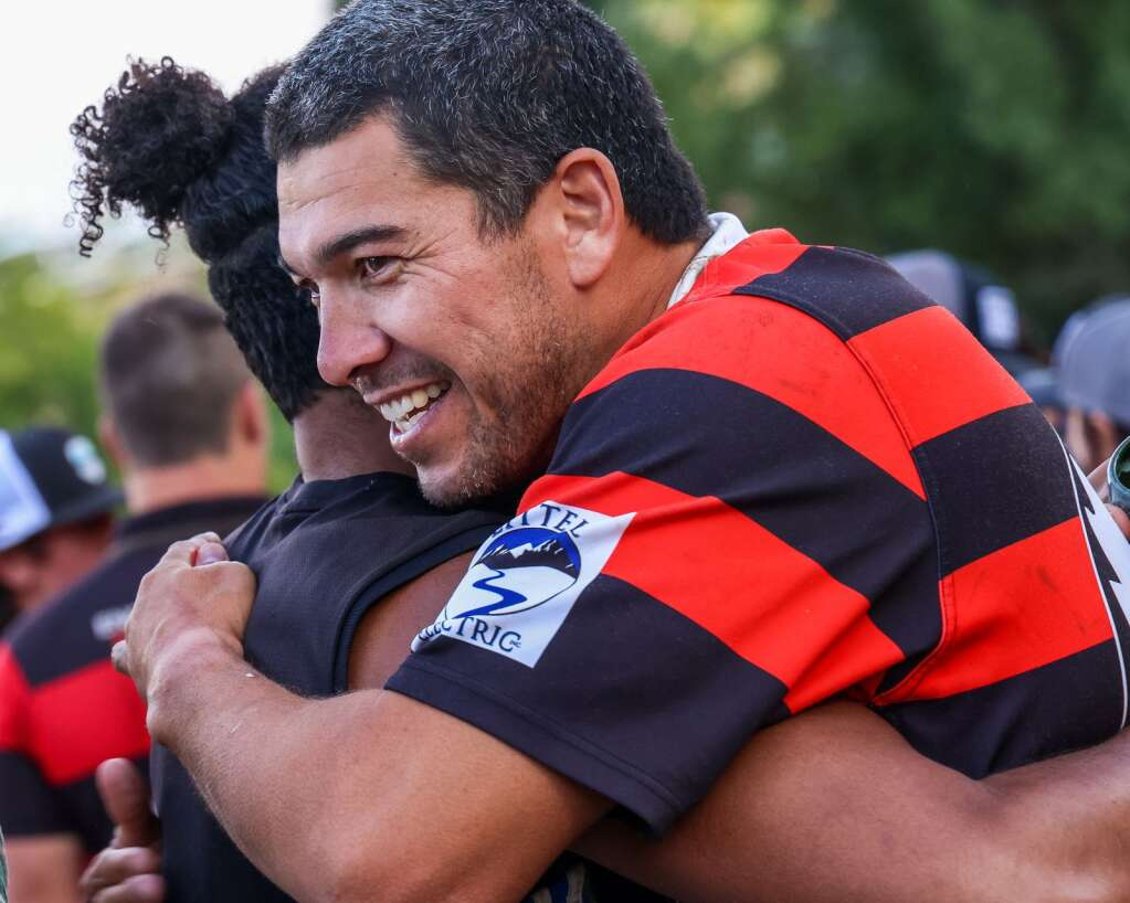 The Gentlemen of Aspen Rugby Club's Mark Gerrard, an Australian rugby icon, gets a hug after their match against the American Raptors in the final of Ruggerfest 53 on Sunday, Sept. 26, 2021, on Wagner Park in downtown Aspen. Photo by Austin Colbert/The Aspen Times.