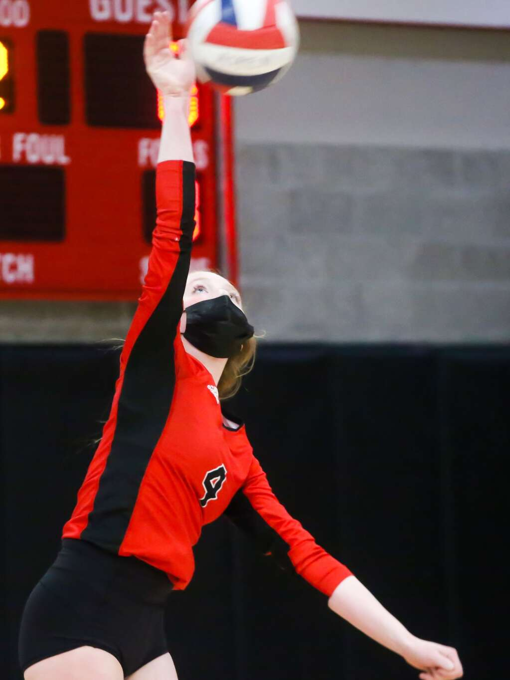 Aspen High School volleyball's Reese Leonard serves against Gunnison on Saturday, April 17, 2021, inside the AHS gymnasium. Gunnison won, 3-1. Photo by Austin Colbert/The Aspen Times.