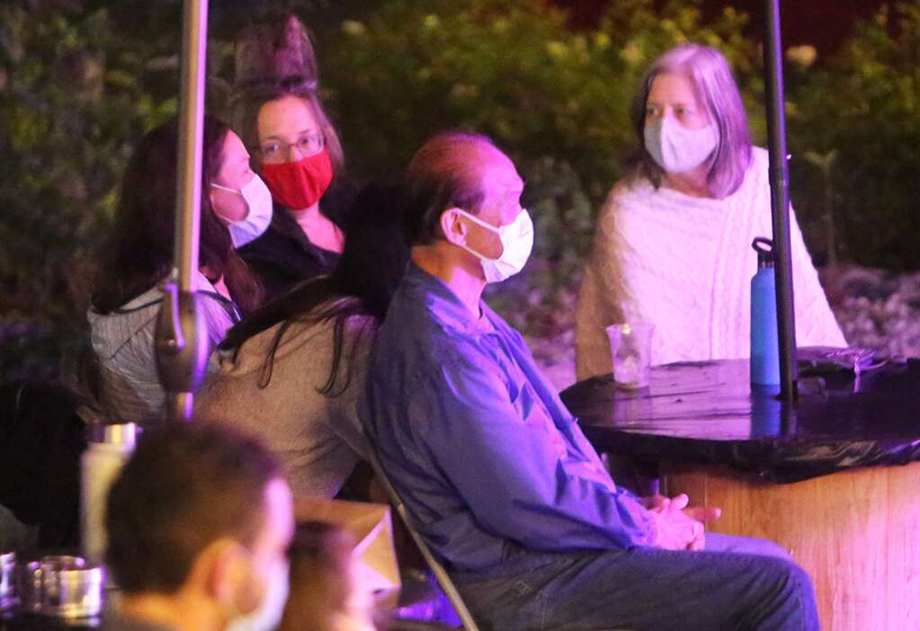 Folks don their face masks while seated at their tables for added precaution. The outdoor and socially distant events at the Miners Foundry ask folks to wear their masks when up from their tables, going inside to order drinks, or using the restroom. | Photo: Elias Funez