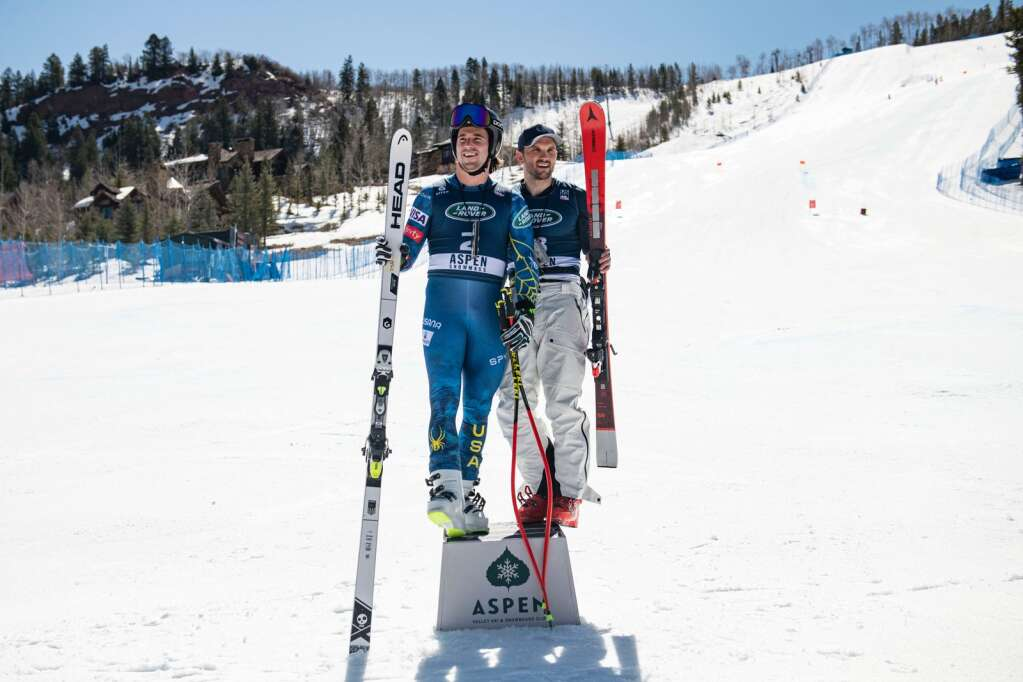 Jared Goldberg, left, and Thomas Biesemeyer stand on the podium after tying for first place in the Men's Downhill National Championships at Aspen Highlands on Saturday, April 10, 2021. (Kelsey Brunner/The Aspen Times)