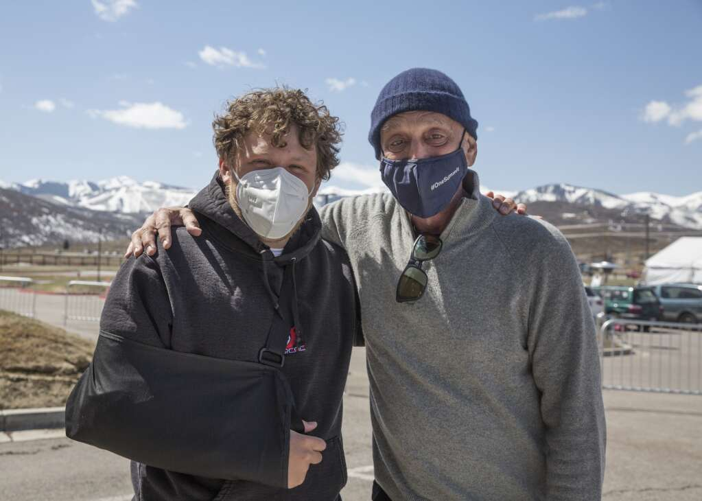 Volunteer duo Josh Batiste-Sertner, left, and Bob Sertner pose for a portrait at the Utah Film Studios vaccination location. Bob Sertner has worked nearly 20 shifts and says the rewarding experience keeps him coming back. | Tanzi Propst/Park Record