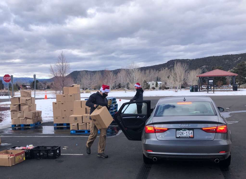 A final vehicle pulls through the mobile food pantry at Crown Mountain Park on Tuesday. Skico workers passed out food to about 350 households. | Scott Condon/The Aspen Times