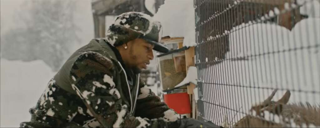 """Key Glock feeding a goat at T-Lazy-7 Ranch in the """"Aspen"""" music video."""