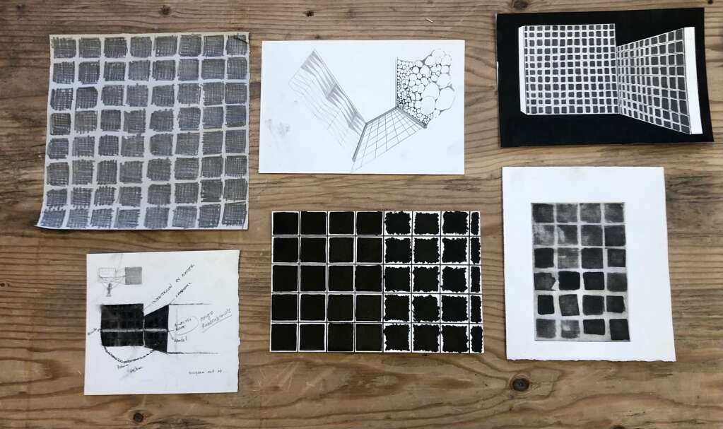 Sketches by Oolite artist-in-residence Nathalie Alfonso show early iterations of a grid sculpture she is working on at Anderson Ranch Arts Center. Alfonso ultimately decided to make the sculpture white instead of black after observing the