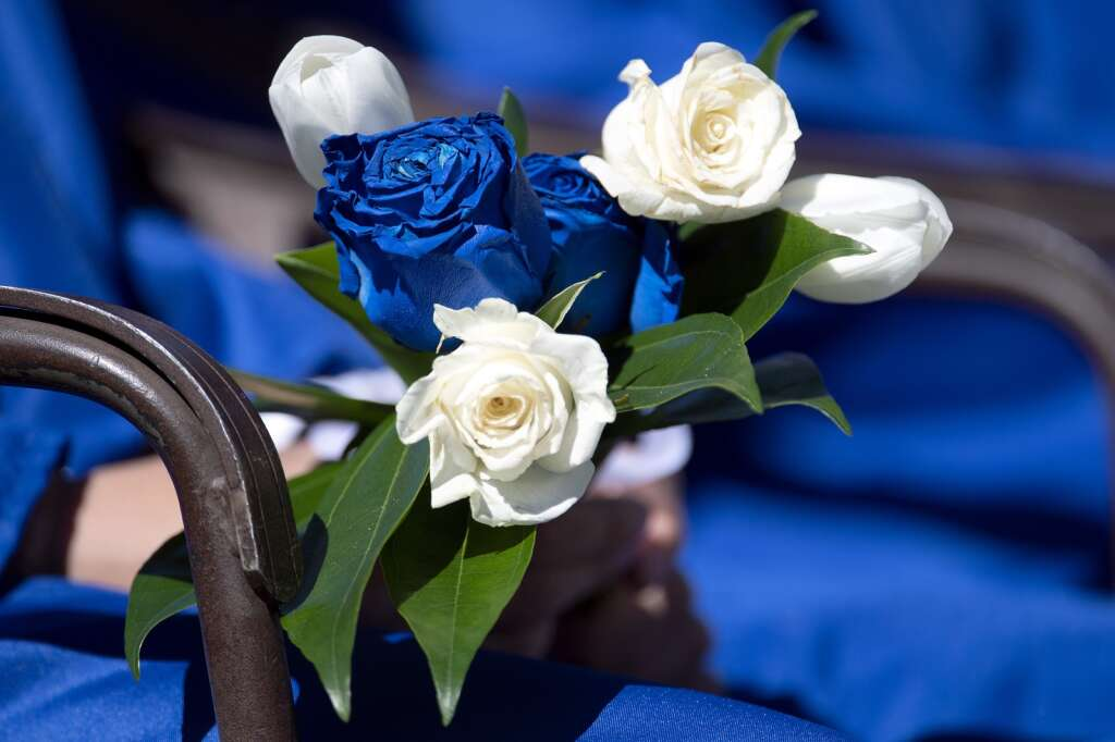 A graduating senior holds roses during The Peak School graduation at Copper Mountain Resort on Thursday, May 27.   Photo by Jason Connolly /Jason Connolly Photography