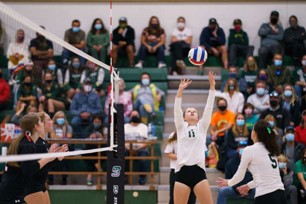 Kayla Hanson sets the ball to a waiting teammate during the Tigers' homecoming match against the Eagle Valley Devils on Monday, Sept. 20, at Summit High School in Breckenridge. | John Hanson/For the Summit Daily News
