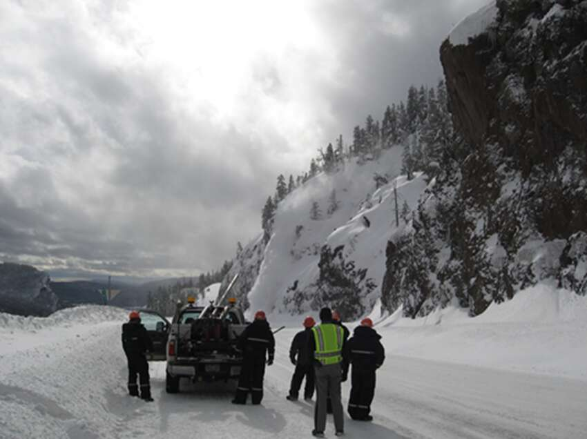 A CDOT crew blasts the side of a mountain with an avalauncher. | Photo from Colorado Department of Transportation