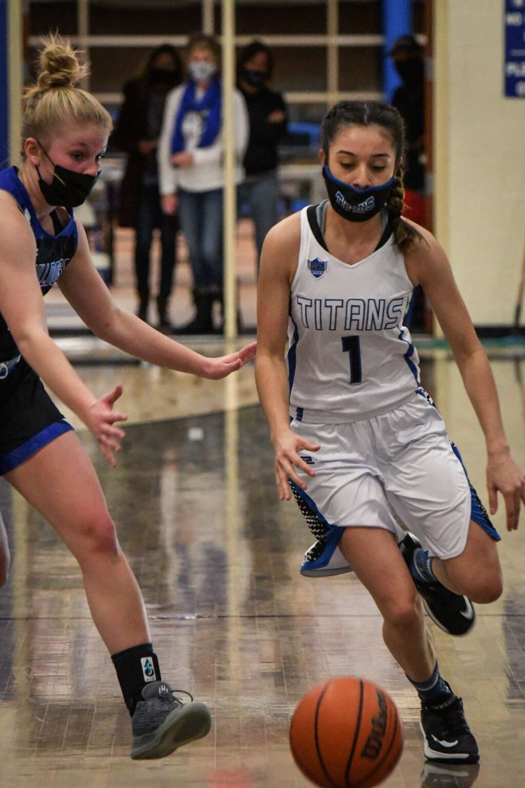 Coal Ridge Titan Jackie Camunez dribbles the ball past the defending Moffat County Bulldog during Tuesday night's game at Coal Ridge High School. | Chelsea Self / Post Independent