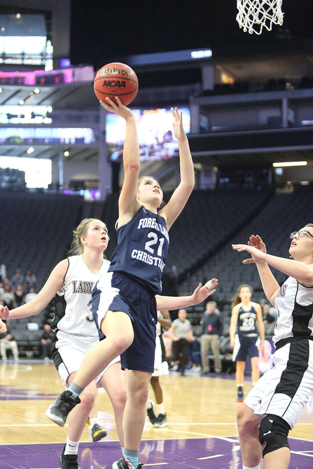 Forest Lake Christian's Ellie Wood (21) goes up for a lay-up against Valley Christian during a section title game at the Golden 1 Center in February. | Photo: Elias Funez
