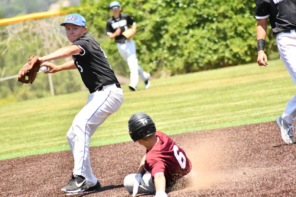 Greg Spears of Moffat County High School baseball turns a double play against Berthoud Monday during the baseball playoffs in Denver.   Andy Bockelman / For the Craig Press