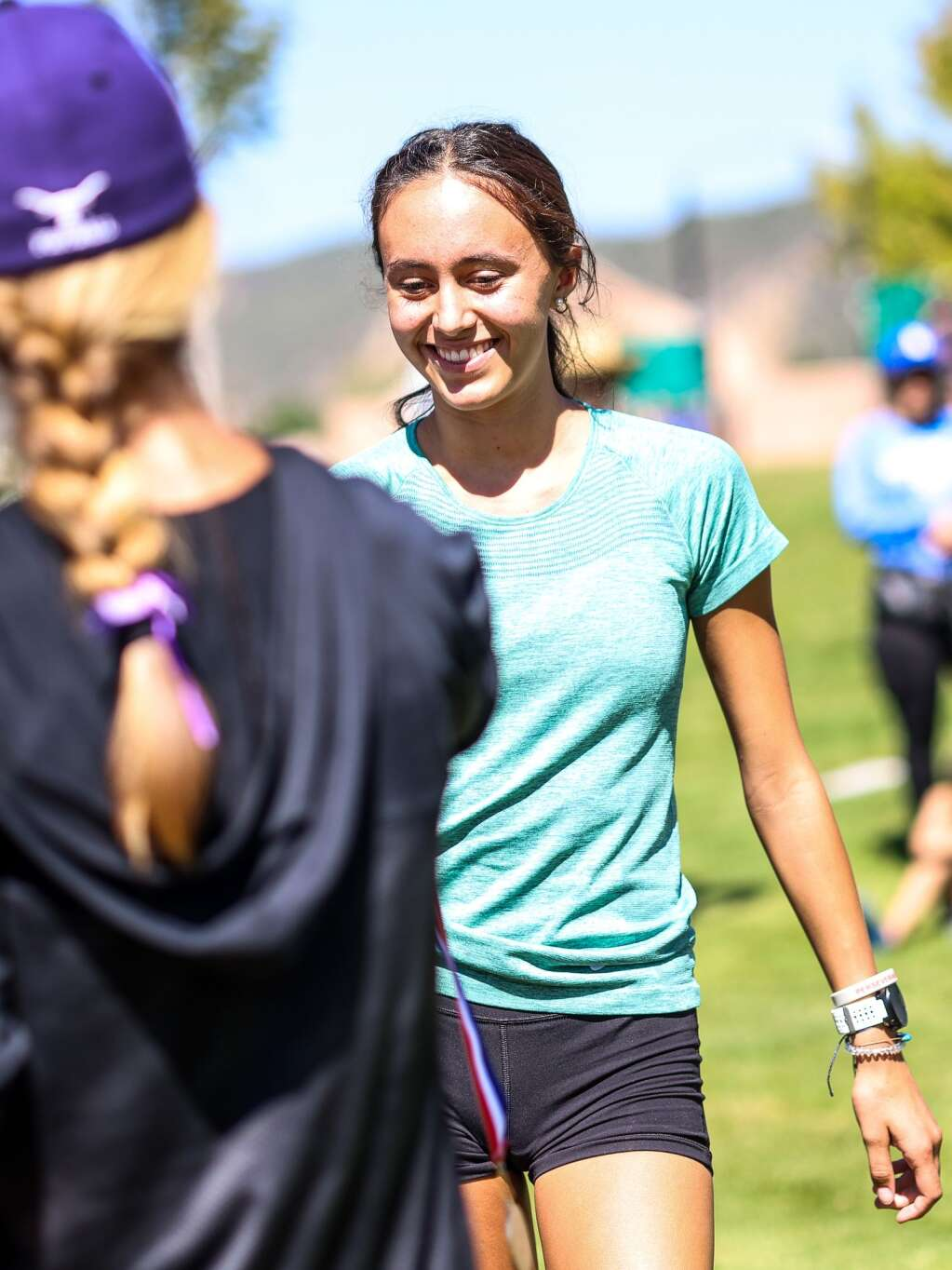 Basalt junior Ava Lane receives her medal for finishing seventh in the Longhorn Invitational cross country meet on Saturday, Aug. 28, 2021, at Crown Mountain Park in El Jebel. Photo by Austin Colbert/The Aspen Times.