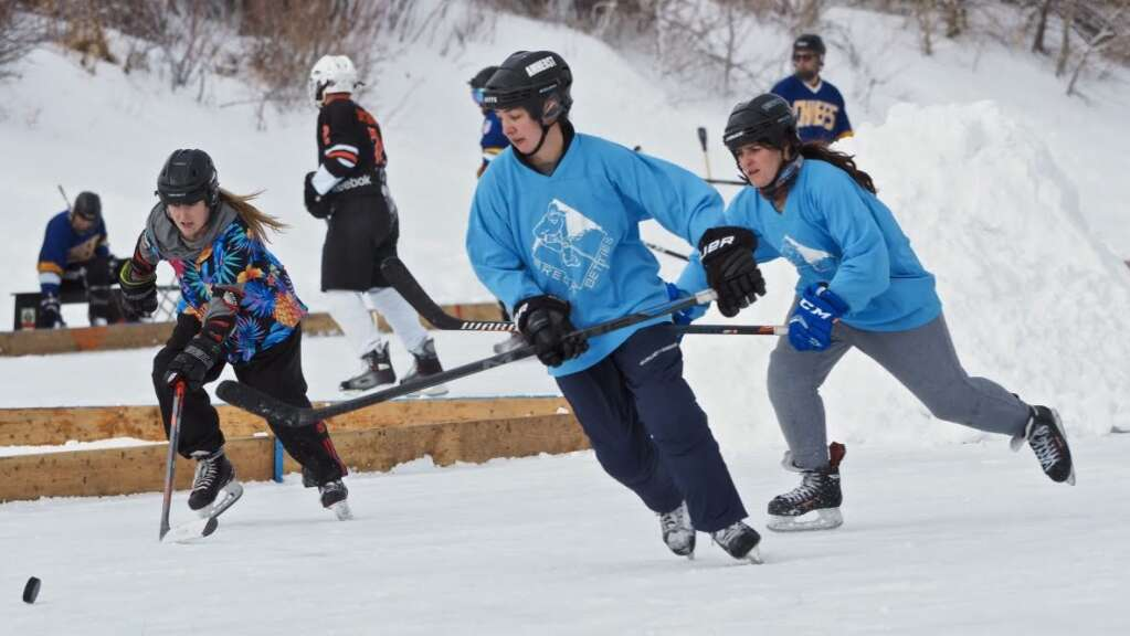 The local Pucking Critters women's championship pond hockey team skates during last weekend's Pabst Blue Ribbon Colorado Pond Hockey Tournament at North Pond Park in Silverthorne.   Photo by Elaine Collins