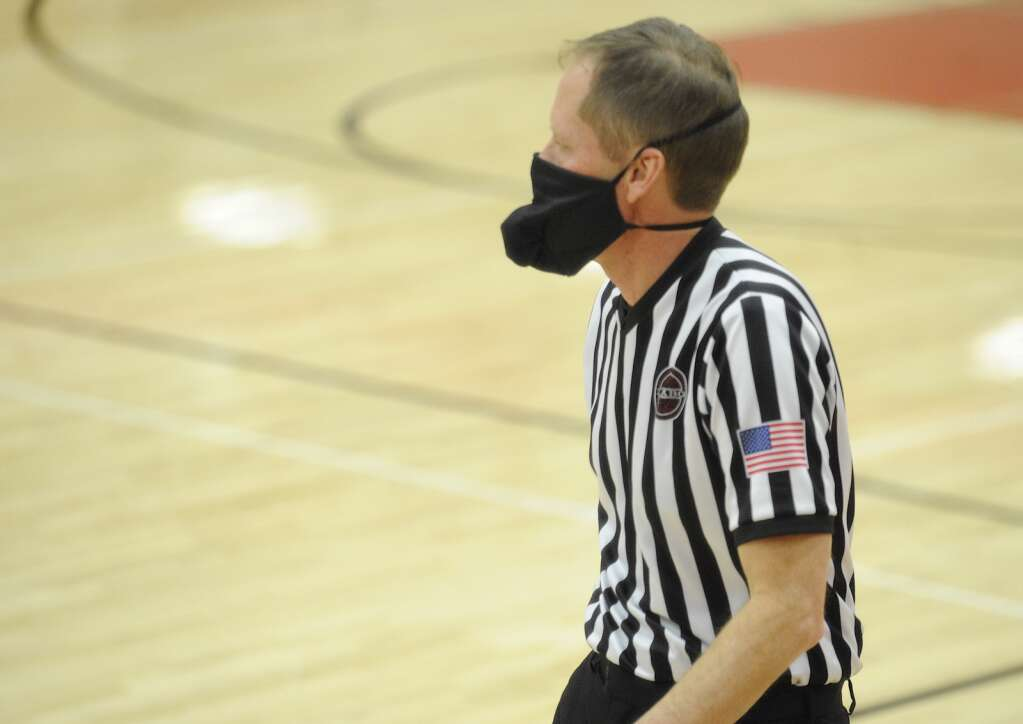Referees donned special masks that had an extra pocket to hold their whistles at the Steamboat Springs girls basketball home opener against Coal Ridge in Kelly Meek Gym on Wendesday night.