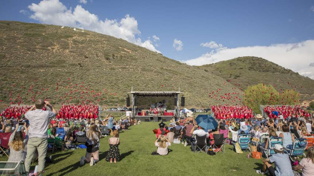 The Park City High School graduating class of 2021 toss their caps into the air at the conclusion of their commencement ceremony on the North 40 playing fields Thursday evening, June 3, 2021. Parents, friends and other attendees applauded, stood to film and took photos of the moment. (Tanzi Propst/Park Record)