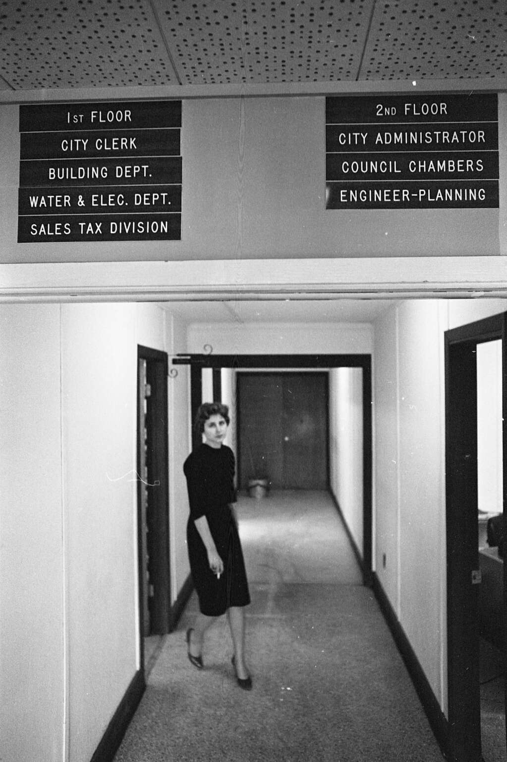 One b/w negative of a woman in City Hall (in the Armory Building), 1966. Related images are in the Aspen Illustrated News on February 3, 1966 (page 6-7). Aspen Historical Society, Hiser Collection
