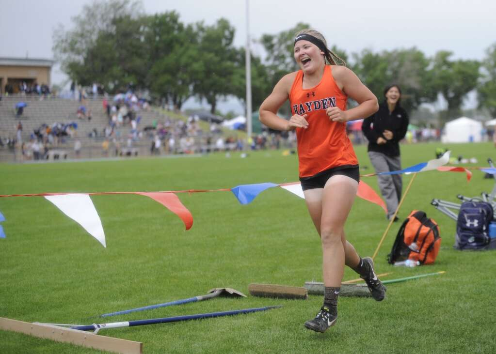 Hayden junior Alison Rajzer celebrates winning her second straight triple jump state championship at the track and field championships at JeffCo stadium on Thursday. (Photo by Shelby Reardon)
