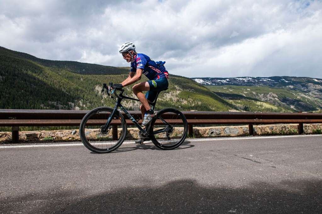 A biker breathes heavily while climbing up Independence Pass during the 2021 annual Ride for the Pass event starting in Aspen on Saturday, May 22, 2021. (Kelsey Brunner/The Aspen Times)
