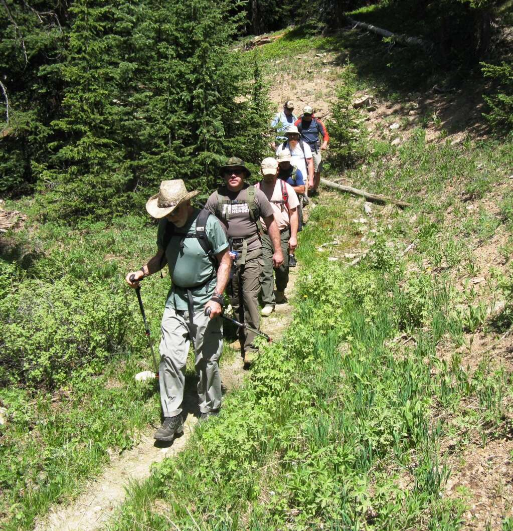 Military veterans and staff members from Huts for Vets hike into the wilderness outside of Aspen during a prior year's program. | Huts for Vets/courtesy photo