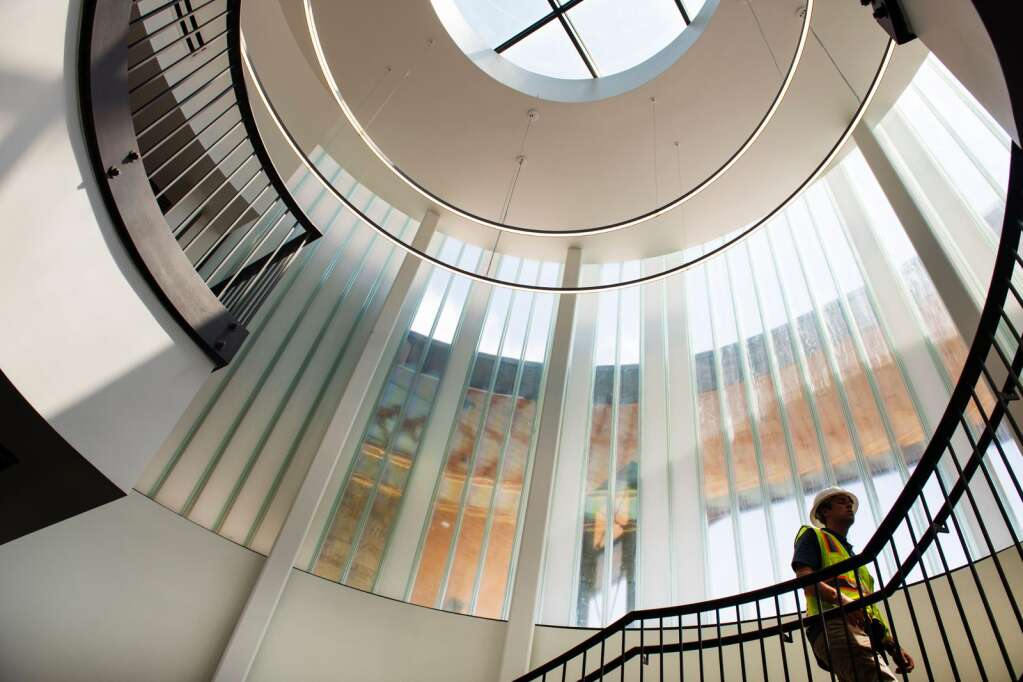 City of Aspen's Capital Asset Director Rob Schober walks up the staircase the leads to the second and third floors through the atrium of the new Aspen City Hall building on Thursday, July 15, 2021. The wrought iron staircase and windowed atrium is the focal point of the new building. (Kelsey Brunner/The Aspen Times)