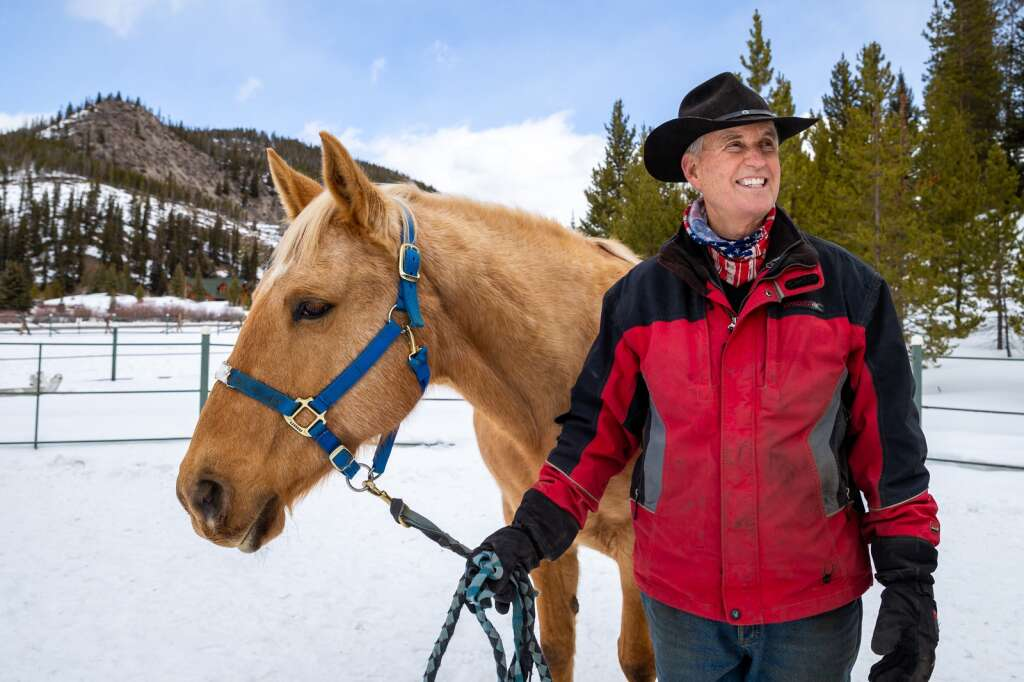 Craig Robelen is pictured Thursday, Jan. 21, with his quarter horse palomino Madara at the Breckenridge Equine Center on Tiger Road.   Photo by Liz Copan / Studio Copan