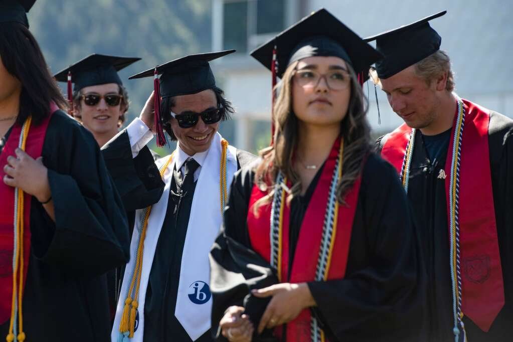 An Aspen High School graduate stands before the commencement ceremony on the turf field on Saturday, June 5, 2021. (Kelsey Brunner/The Aspen Times)
