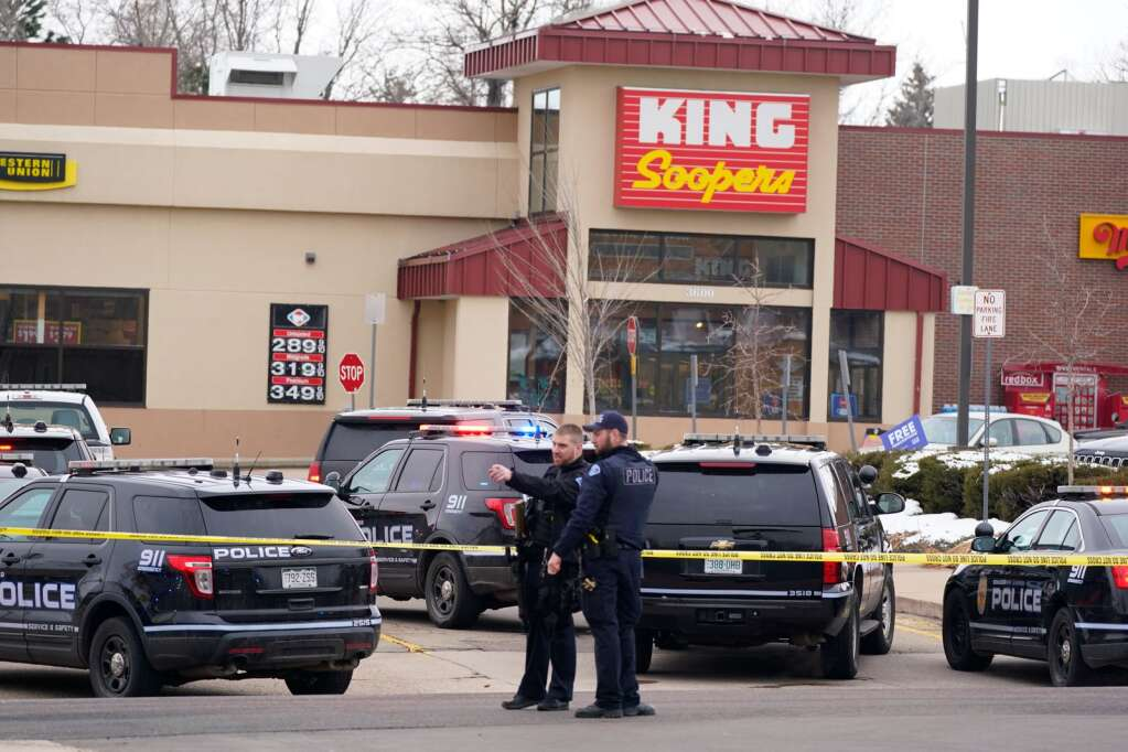 Police outside a King Soopers grocery store where a shooting took place Monday, March 22, 2021, in Boulder, Colo.  (AP Photo/David Zalubowski)