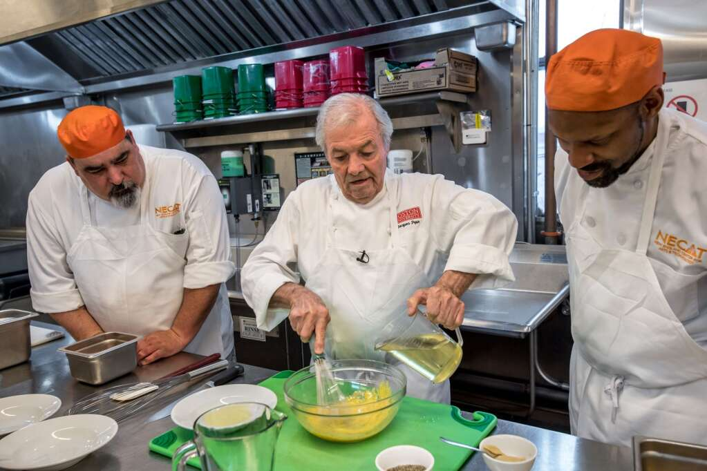 Jacques Pépin works with students at the New England Culinary Arts Training center in Boston in 2018. | Courtesy of the Jacques Pépin Foundation