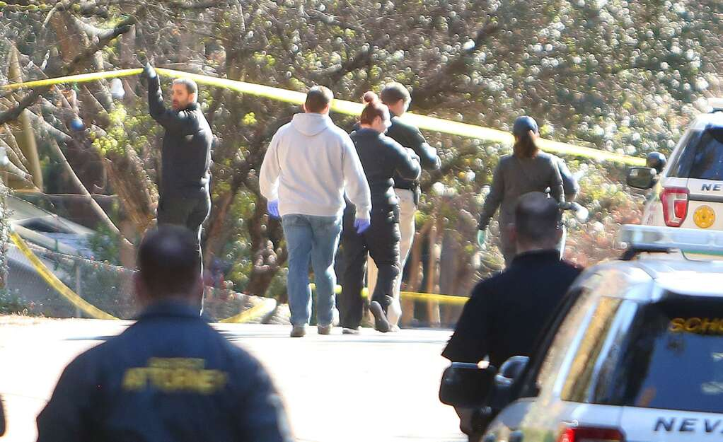 Law enforcement personnel continue their investigation into the fatal officer involved shooting that occurred New Year's Day at Oak Street and Walker Drive. | Photo: Elias Funez