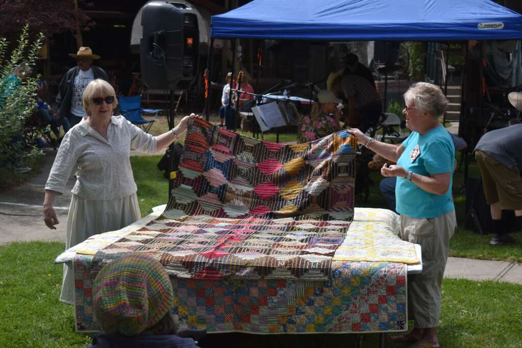 People showcase a quilt during Silt Heyday on Saturday. |Ray K. Erku / Post Independent